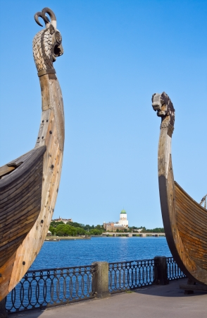Swedish ancient castle in the background of Drakkar Viking in Vyborg, Russia photo