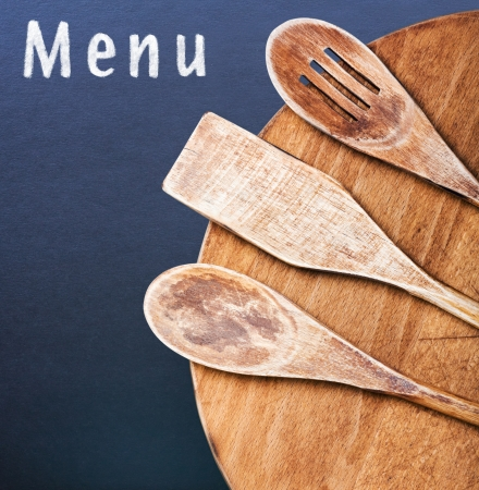 Wooden kitchen utensils and an inscription in chalk menu photo