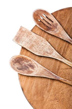 Wooden kitchen utensils isolated on white background photo