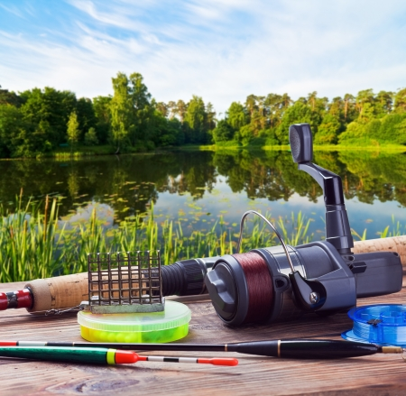 fishing bait: fishing tackle on a pontoon on the background of the lake in the woods