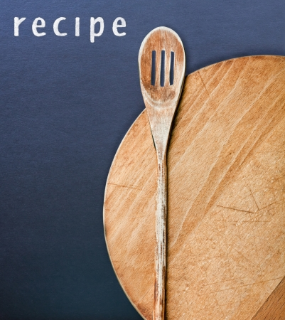 Wooden kitchen utensils and a recipe photo