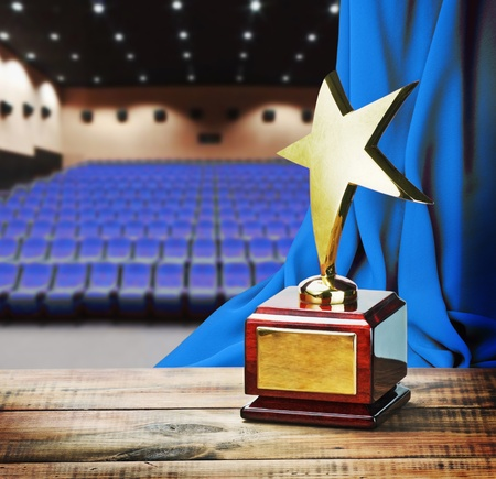 gold plaque: Star award for service to the background of the auditorium