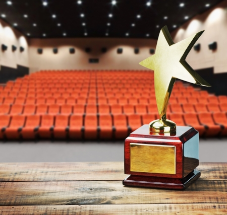 award trophy: Star award for service to the background of the auditorium