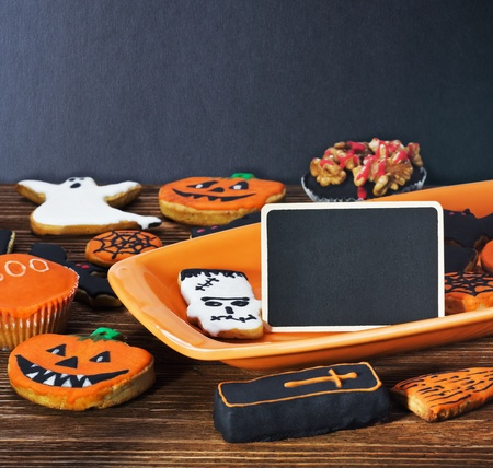 Halloween cookies on a plate orange and blackboard photo