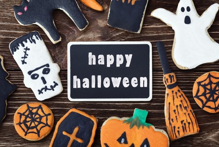 handmade cookies for Halloween and the black plate for greetings. The empty space on the plate can be used for writing or drawing particular congratulations. photo