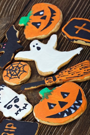 Handmade Halloween cookies on a wooden background photo