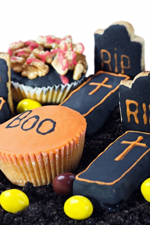 Homemade Halloween cookies and a selection of sweets isolated on white background photo