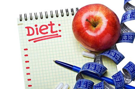 Notatnik z diety i tabletki z pomiaru taśmę Zdjęcie Seryjne