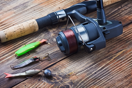 fishing tackle: fishing tackle on a wooden table