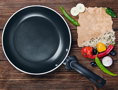 frying pan: rice with vegetables next to a frying pan and paper for recipe Stock Photo