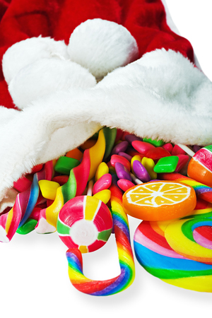 colorful candy in a Christmas sock isolated on white background photo