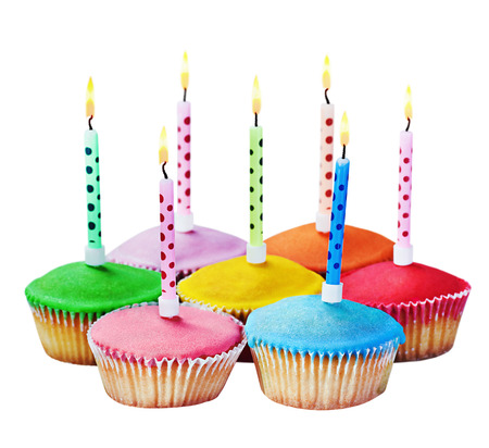 birthday cupcakes: colorful happy birthday cupcakes with candles on white background Stock Photo