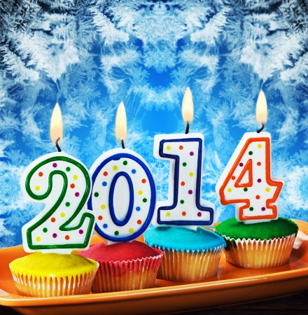 burning candles with the symbol of the new year on the cake Stock Photo