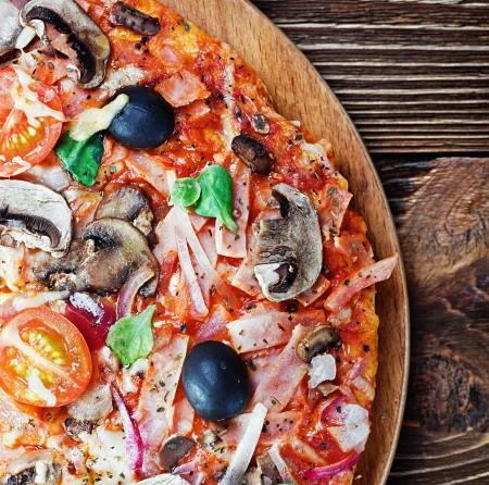 woodfire: pizza with mushrooms and cheese on the table