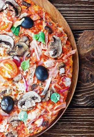 woodfired: pizza with mushrooms and cheese on the table