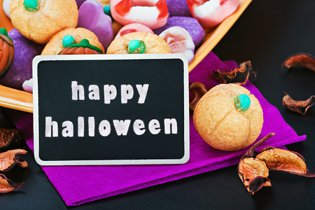 sweets and candies for Halloween and blackboard photo