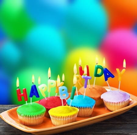 birthday gift: colorful happy birthday cupcakes with candles