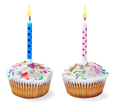 cupcakes with a birthday candle isolated on a white background photo