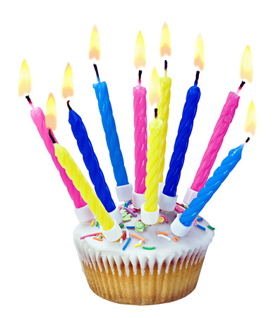 birthday cupcakes: Birthday cupcake with burning candles isolated on white background Stock Photo