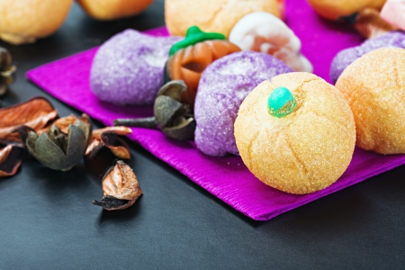 sweets and candy to celebrate Halloween on the table Stock Photo