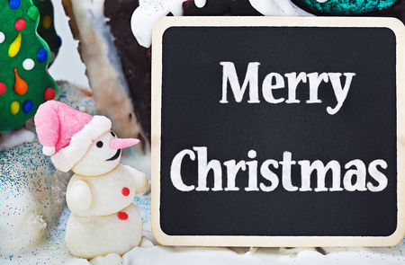 sweet decorations made of gingerbread and candy and greeting Merry Christmas photo