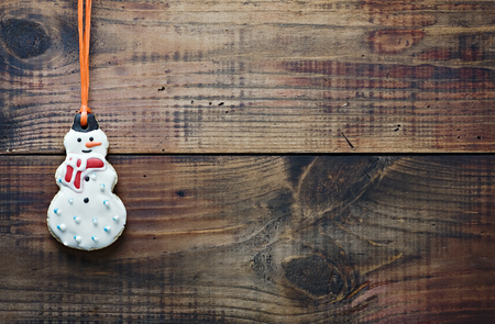 christmas gingerbread cookies hanging over wooden  photo