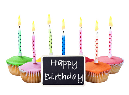 colorful happy birthday cupcakes with candles with compliments photo