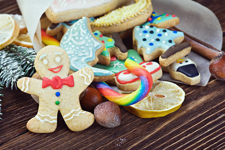 smiling gingerbread man and Christmas decorations for the holiday photo