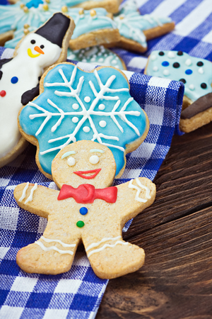 Smiling gingerbread men and Christmas cookies photo