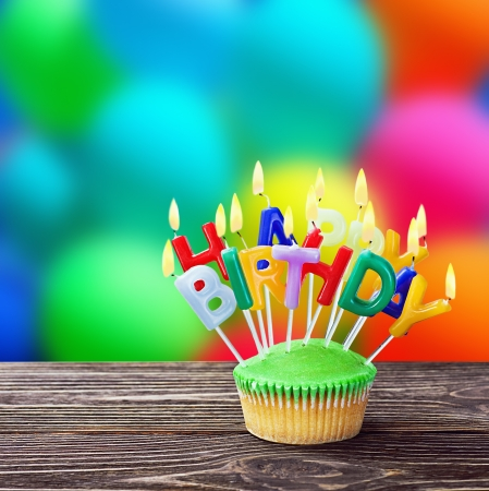 colorful happy birthday cupcakes with candles photo