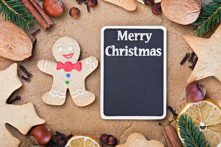 blackboard for writing greetings and ingredients for cooking and baking Christmas cookies photo