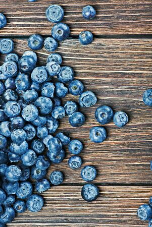 blueberries on old wooden table background photo