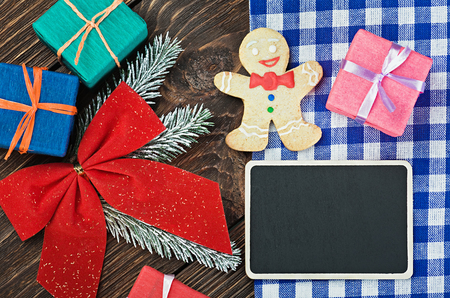 blackboard with a greeting and Christmas decorations photo