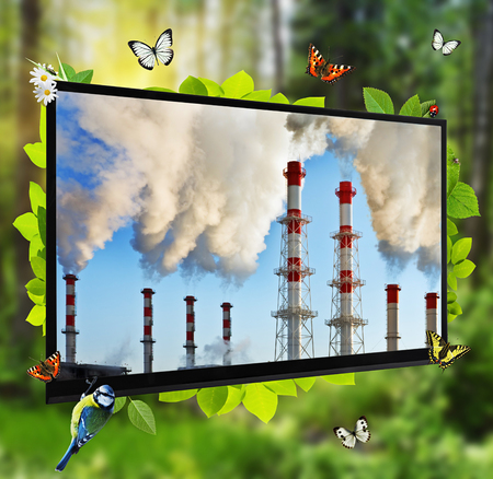 pollution of the environment. TV panel as a window cleaner of forests in the polluted atmosphere. photo