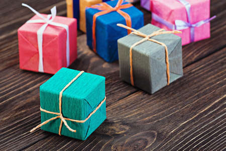 gifts box in a colorful package on the table photo