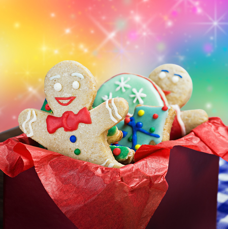 smiling gingerbread man cookies and the rest in a gift box photo