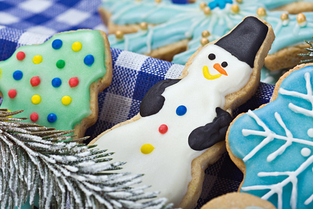 Smiling gingerbread snowman and Christmas cookies photo