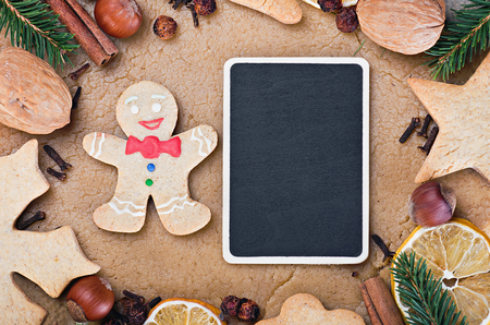 blackboard and ingredients for cooking and baking Christmas cookies photo