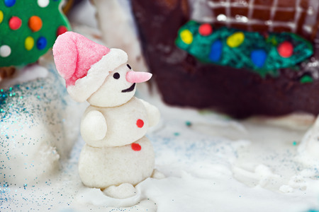 Snowman with sweets and other Christmas decorations photo