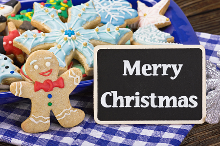 sweets and biscuits for Christmas and a blackboard with a greeting for the holiday photo