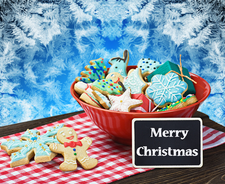 Christmas gingerbread cookies and a blackboard with congratulations photo