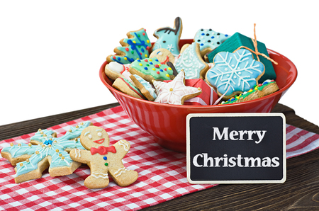 Christmas gingerbread cookies on the table isolated on white  photo