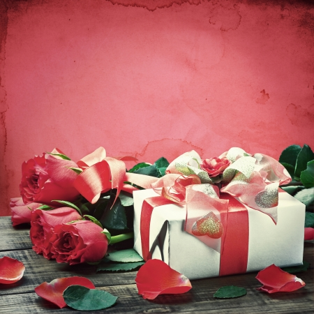 fresh red roses and gift box. toned image photo
