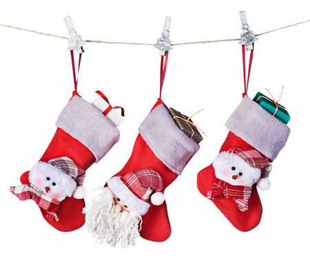 Christmas socks with gifts hanging isolated on a white background Archivio Fotografico