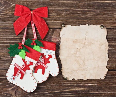 Christmas socks with gifts hanging on the wooden wall photo