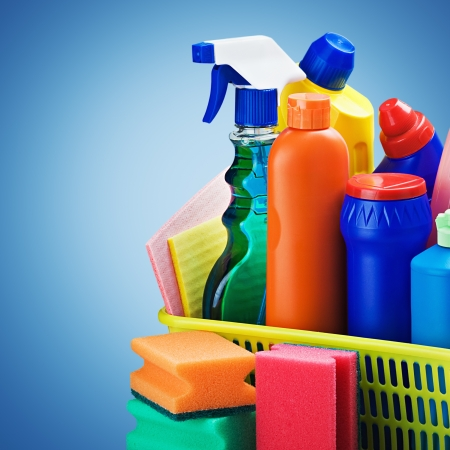 sanitizing: cleaners supplies and cleaning equipment on a blue background Stock Photo