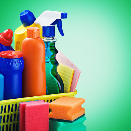 cleaners supplies and cleaning equipment on a green background photo