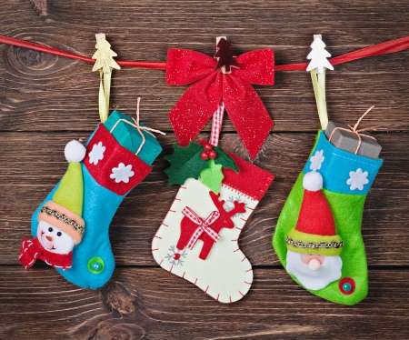 Christmas socks with gifts hanging on the wall Stok Fotoğraf