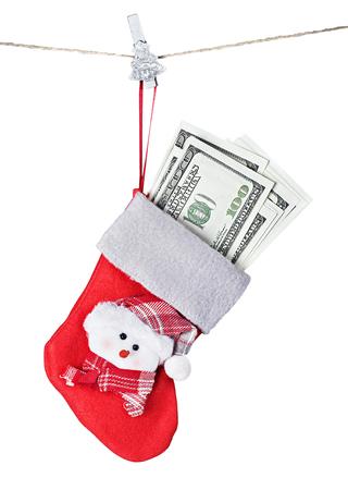 Christmas Stocking Stuffed with Money isolated on white