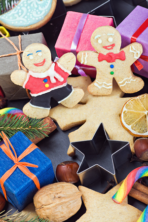 smiling on the background of Christmas gingerbread decorations photo